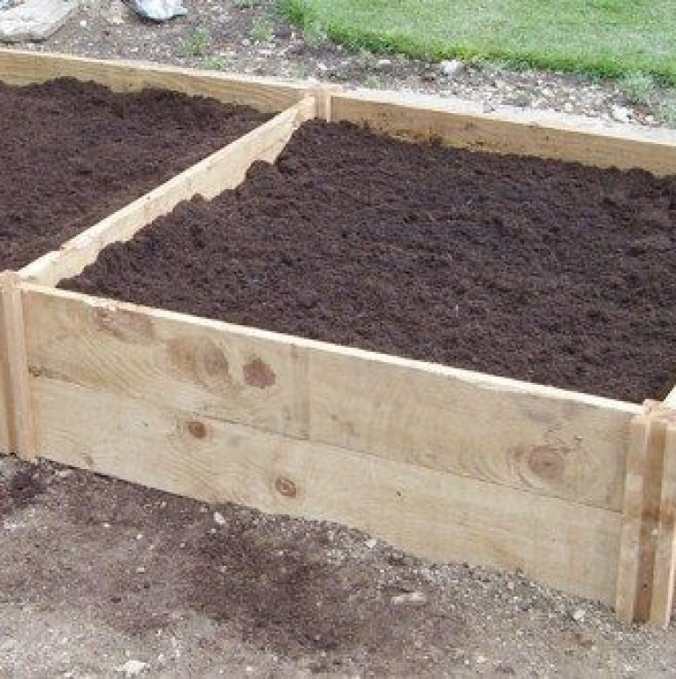 Deep raised wooden bed